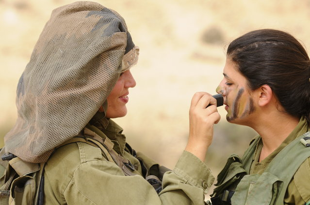 """Field Training Week for Ground Forces"", May 17, 2011.  Weeks of exhausting practice all come down to a single moment- the concluding exercise that will award these female soldiers the title of combat instructors. At the end of the course the female soldiers will be placed in different positions, instructing IDF Ground Forces. Minutes before stepping foot in the simulated battlefield, they make their final preparations."