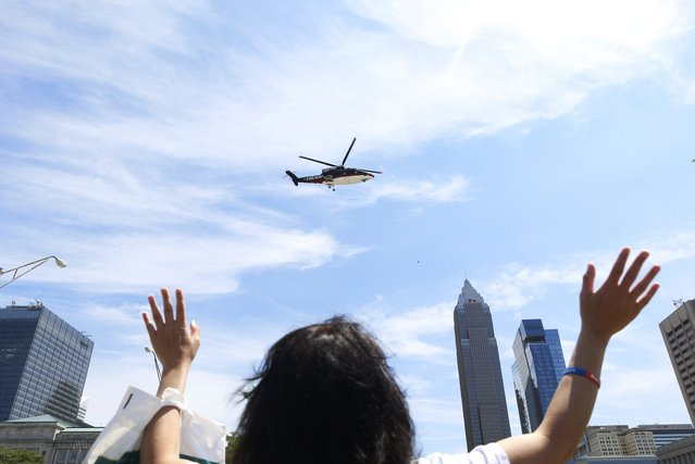 A woman waves towards the helicopter carrying Republican U.S. presidential nominee Donald Trump before an event in Cleveland, Ohio, U.S. July 20, 2016. (Photo by Lucas Jackson/Reuters)