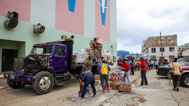 A handout photo made available by the British Ministry of Defence (MOD) on 19 September 2017 shows the team of Royal Marines and staff from Social Services Relief distributing aid, on the British Virgin Islands, 18 September 2017. Royal Marines from 40 Commando have been ensuring aid reaches people across the island before Storm Maria arrives. Hurricane Maria, upgraded to Category 5 storm, has rapidly intensified according to the US National Hurricane Center (NHC). (Photo by LPhot Joel Rouse/EPA/EFE)