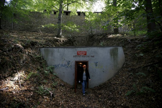 """A woman walks out from the entrance of tunnels, which are part of the Nazi Germany """"Riese"""" construction project, now used by the Institute of Geophysics, Polish Academy of Sciences (PAN) under the Ksiaz castle in an area where a Nazi train is believed to be, in Walbrzych, southwestern Poland September 3, 2015. (Photo by Kacper Pempel/Reuters)"""