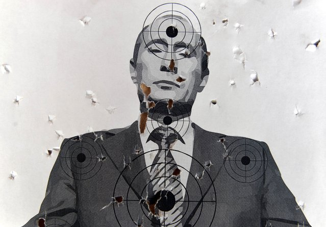 "A target depicting a portrait of Russian President Vladimir Putin, in a shooting range in the center of the western Ukrainian city of Lviv, on August 31, 2014. Russian President Vladimir Putin called on August 31 for immediate talks on the future of war-torn east Ukraine, saying for the first time that ""statehood"" should be discussed. (Photo by Yurko Dyachyshyn/AFP Photo)"
