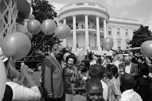 President and Mrs. Johnson greet some of the 1,000 children of low-income families in the district of Columbia gathered on the White House Lawn on September 8, 1968 in Washington for a country fair. The President's daughter, Lynda Hobb is in background. (Photo by Harvey Georges/AP Photo)
