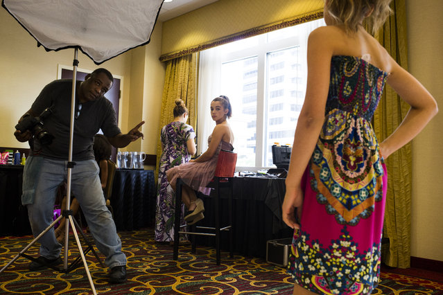 Madisyn Martinelli, 12, of New Milford, Conn., watches as Sammie Judis, 13, of Veinna, Va., poses for a portrait during an indoor studio style shoot at a modeling camp at the Courtyard Marriott Hotel in McLean, Va., on Tuesday, August 19th, 2015. (Photo by Brittany Greeson/The Washington Post)