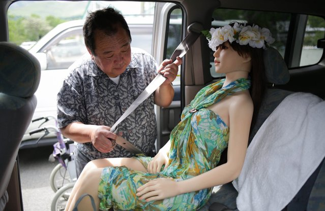 "Senji Nakajima fasten seatbelt for his love doll ""Saori"" on June 5, 2016 in Nagano, Japan. (Photo by Taro Karibe/Getty Images)"