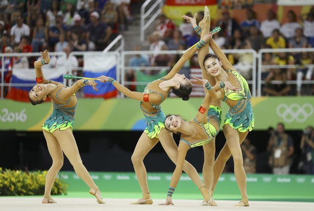 2016 Rio Olympics, Rhythmic Gymnastics, Preliminary, Group All-Around Qualification, Rotation 1, Rio Olympic Arena, Rio de Janeiro, Brazil on August 20, 2016. Team China (CHN) compete using clubs and hoops. (Photo by Mike Blake/Reuters)