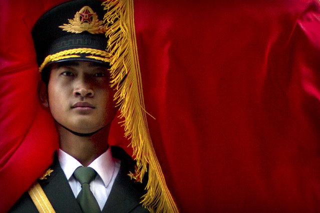 The wind blows a flag around a Chinese honor guard member before a welcome ceremony for Panamanian President Juan Carlos Varela at the Great Hall of the People in Beijing, Friday, November 17, 2017. Varela was making his first state visit to Beijing on Friday after breaking off relations with Taiwan and establishing formal ties with China five months ago. (Photo by Mark Schiefelbein/AP Photo)
