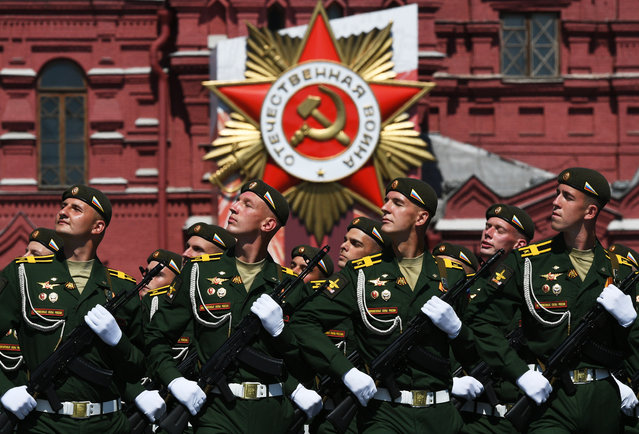 Russian servicemen march during a military parade, marking the 75th anniversary of the Nazi defeat, in Moscow, Russia, 24 June 2020. (Photo by Ramil Sitdikov/EPA/EFE)
