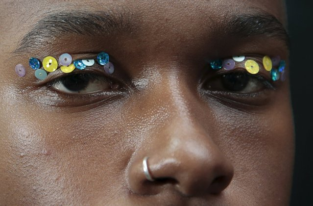 A model presents a creation backstage from the Ashish Spring/Summer 2016 collection during London Fashion Week in London, Britain September 22, 2015. (Photo by Suzanne Plunkett/Reuters)