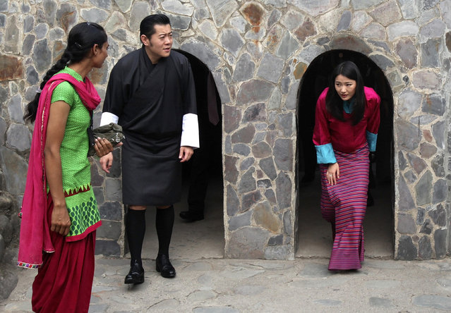 Bhutan's King Jigme Khesar Namgyel Wangchuck (2nd L) and Queen Jetsun Pema (R) emerge from arch-shaped passages as they visit the Rock Garden in Chandigarh October 5, 2014. (Photo by Ajay Verma/Reuters)