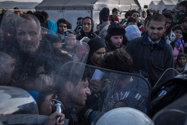 Migrants are pushed back after crowding over police cordons to enter Macedonia at the Greek-Macedonian border. Thousands of migrants were stranded on the Greek side after Macedonia blocked access to citizens of countries that were not being fast-tracked for asylum in the European Union. Macedonia now allows only citizens from Syria, Iraq and Afghanistan. (Photo by Sergey Ponomarev/Getty Images)
