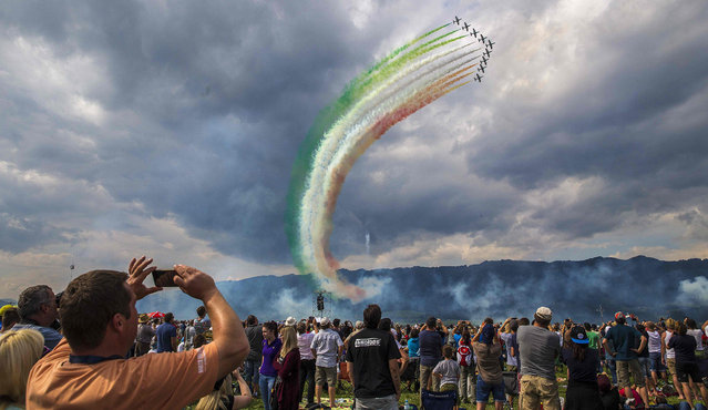 """The squad of Frecce Tricolori from the Italian Airforce performs during the Airshow """"Airpower 16"""" on September 2, 2016, in Zeltweg, Austria. (Photo by Erwin Scheriau/AFP Photo/APA)"""