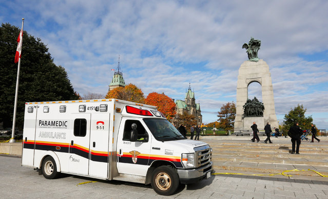 An ambulance is pictured alongside the Canadian War Memorial following a shooting incident in Ottawa October 22, 2014. (Photo by Chris Wattie/Reuters)