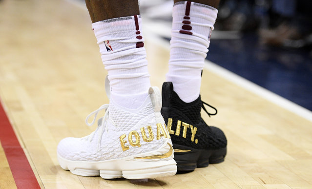 """Cleveland Cavaliers forward LeBron James' shoes are emblazoned with """"EQUALITY"""" on both heels during the first half of an NBA basketball game against the Washington Wizards, Sunday, December 17, 2017, in Washington. (Photo by Nick Wass/AP Photo)"""