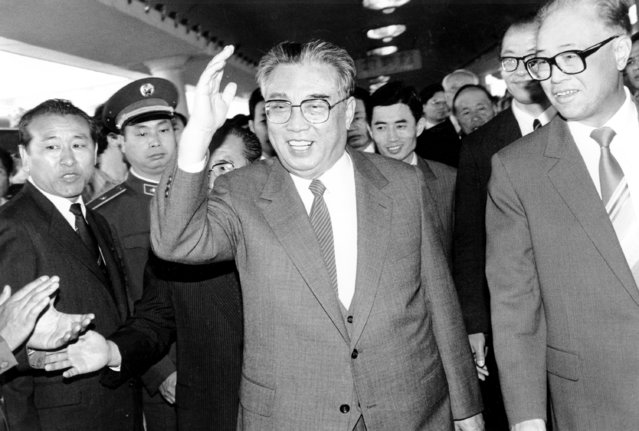 In this May 21, 1987, file photo, then North Korean President Kim Il Sung, center, and then Chinese Premier Zhao Ziyang make their way through a crowd of well-wishers at the train station in Beijing. North Korean leader Kim Jong Un's two-week absence from public view has inspired speculation and rumors, but past disappearances of North Korea's ruling elite frequently have simply shown the disconnect between insatiable curiosity about the country and the secrecy surrounding its leadership. (Photo by Neal Ulevich/AP Photo/File)