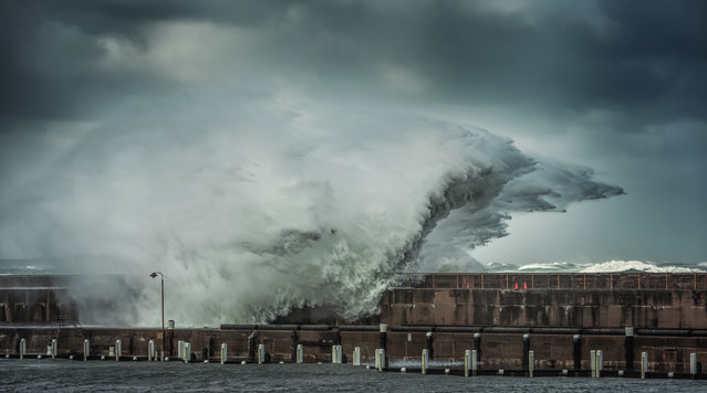 """Smashing"". The Warrnambool Breakwater was smashed by wild wind and even wilder swells on the 24th of July 2014. Photo location: Warrnambool, Victoria, Australia. (Photo and caption by Dan Atkinson/National Geographic Photo Contest)"