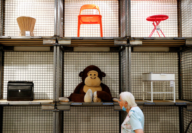 """A customer is pictured at Berlin's waste management arm BSR (Berliner Stadtreinigung) second-hand store """"Nochmall"""", which reads once again, which is selling goods that consumers have tossed as trash but that may be someone else's treasure, in Berlin, Germany, August 14, 2020. (Photo by Fabrizio Bensch/Reuters)"""