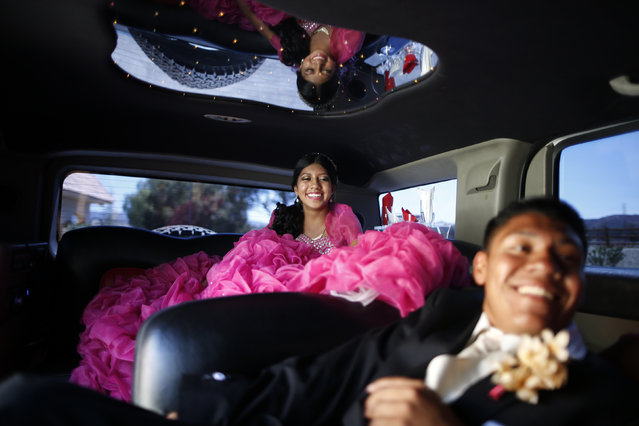 Mimi Pineda, 15, whose parents are from El Salvador, rides to church in a limousine with her friend Christian Flores, 17, during her quinceanera in Santa Clarita, California August 23, 2014. Quinceanera is a rite of passage celebrated on the fifteenth birthday of many female Latino teenagers. (Photo by Lucy Nicholson/Reuters)
