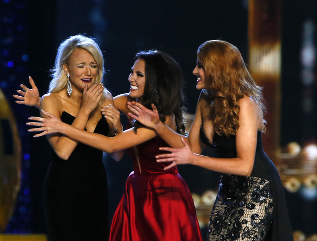 Miss Arkansa Savvy Shields, is congratulated by Miss Maryland Hannah Brewer, center, and Miss Texas  Caroline Carothers, after being named Miss America 2017, Sunday, September 11, 2016, in Atlantic City, N.J. (Photo by Noah K. Murray/AP Photo)