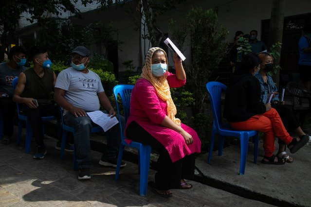 Peoples wearing facemasks are seen waiting for their turn to donate blood during the second lockdown imposed by the local government as a preventive measure against the spread of Coronavirus (COVID-19) in Kathmandu, Nepal on September 5, 2020. Gokarneshwor Municipality volunteer operational committee and Narayantar youth club have jointly organized a blood donation camping to address the scarcity of blood during the Coronavirus (COVID-19) pandemic. A total of 90 people have donated blood in this program. (Photo by Prabin Ranabhat/SOPA Images/LightRocket via Getty Images)