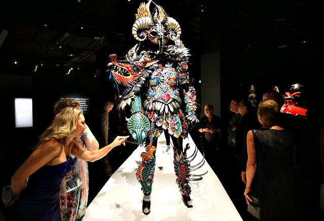 Guests look at the exhibits on show at the Auckland War Memorial Museum's World of Wearable Art (WOW) exhibition opening at Auckland Museum on November 20, 2014 in Auckland, New Zealand. (Photo by Michael Bradley/Getty Images for Auckland War Memorial Museum)