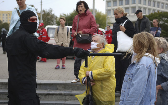 Women argue with a police officer during an opposition rally to protest the official presidential election results in Minsk, Belarus, Sunday, September 27, 2020. (Photo by TUT.by via AP Photo)