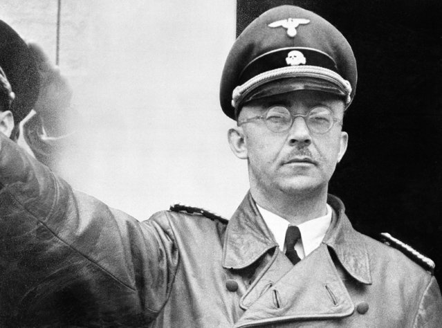 The undated file photo shows German Nazi party official and head of the SS, Heinrich Himmler. at unknown location in Germany. (Photo by AP Photo)