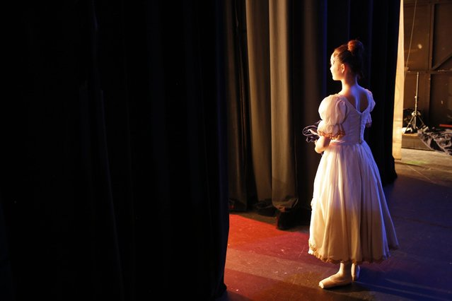 "A ballerina from the Joburg Ballet prepares to enter the stage during the final dress rehearsal of ""Cinderella"" at the Civic Theater in Johannesburg, South Africa, 29 September 2016. The ballet company has included some children from their township ballet school in the performance of this classical ballet. (Photo by Kim Ludbrook/EPA)"