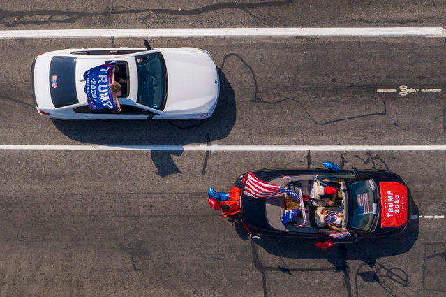 This aerial view shows supporters of the US President, who is being treated for Covid-19, taking part in a caravan as they rally for his reelection in Glendale, California, on October 4, 2020. (Photo by David McNew/AFP Photo)