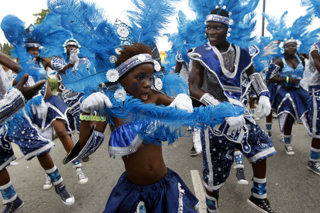 Participants attend a street carnival marking the end of Easter celebrations at Tafawa Balewa square in Nigeria's commercial capital Lagos April 1, 2013. (Photo by Akintunde Akinleye/Reuters)