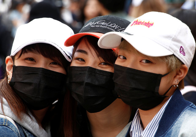 Japanese women wearing masks to prevent pollen allergy and for fashion, pose for photographs at Harajuku shopping district in Tokyo, Japan March 15, 2018. (Photo by Kim Kyung-Hoon/Reuters)