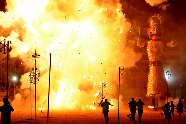Effigies of demon Ravana, Kumbhkaran and Meghnath being set on fire by Lord Rama during the Dusshera celebrations at Ramila Ground, on October 11, 2016 in New Delhi, India. Ramleela is a dramatic folk re-enactment of the life of Rama, ending up in ten-day battle between Rama and Ravana, as described in the Hindu religious epic, the Ramayana. (Photo by Virendra Singh Gosain/Hindustan Times via Getty Images)