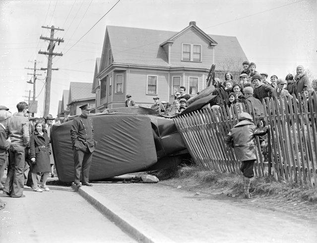 Car goes through fence, 1931. (Photo by Leslie Jones)