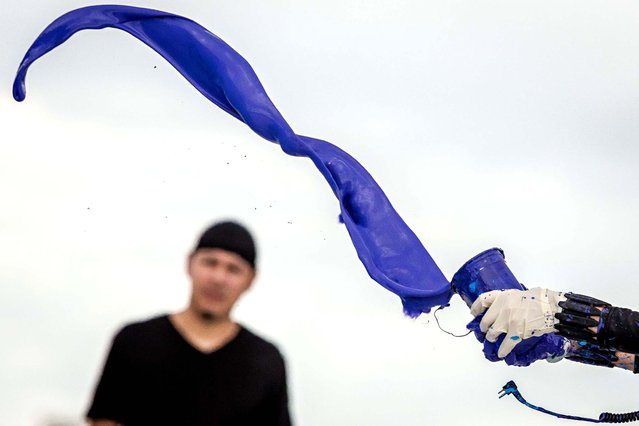Princess Tarinan tosses a column of purple paint into the jet wash. (Photo by Thomas Cordy/The Palm Beach Post)