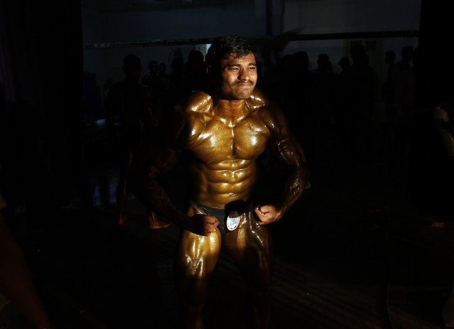 A competitor flexes his muscles backstage during the 53rd Mr. India bodybuilding competition in the southern Indian city of Chennai May 8, 2013. Around 300 bodybuilders from across India participated in the competition on Wednesday. (Photo by Reuters/Babu)