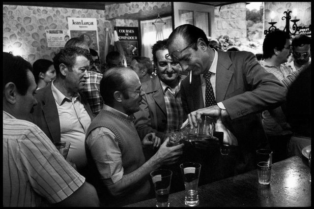 Correze, France, 1982. Jacques Chirac (right), president of the RPR Party, drinks with voters in a bar while visiting his constituency. (Photo by Abbas Attar/Magnum Photos)