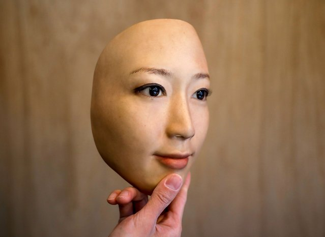 Shuhei Okawara, 30, owner of mask shop Kamenya Omote, shows off a mask based on a real person's face, in Tokyo, Japan on December 16, 2020. (Photo by Issei Kato/Reuters)