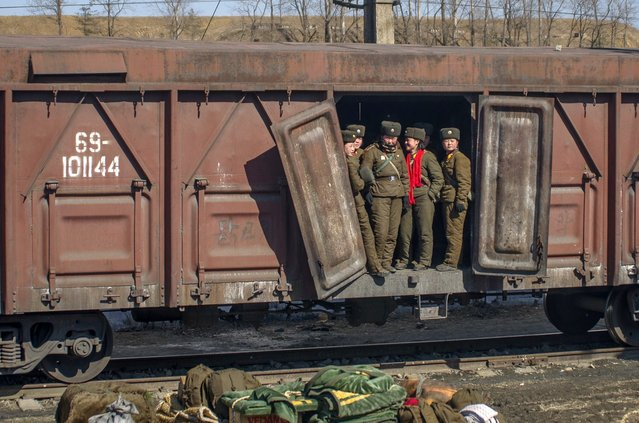 Female soldiers stand in a train car outside of Pyongyang, Feburary 2012. (Eric Testroete)