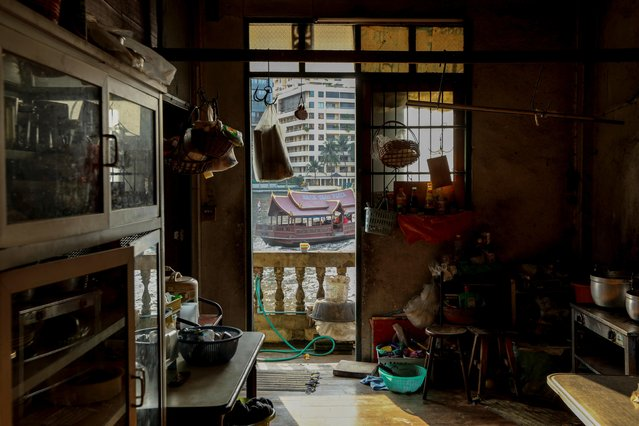 A window in Sasinee Kampheepuchong's kitchen faces the Chao Phraya river in the historic neighborhood of Talad Noi in Bangkok, Thailand on February 6, 2019. A wave of gentrification is sweeping across one of Asia's most vibrant capitals, where change is being thrust upon a melting pot of communities that have for generations resisted it. (Photo by Jorge Silva/Reuters)