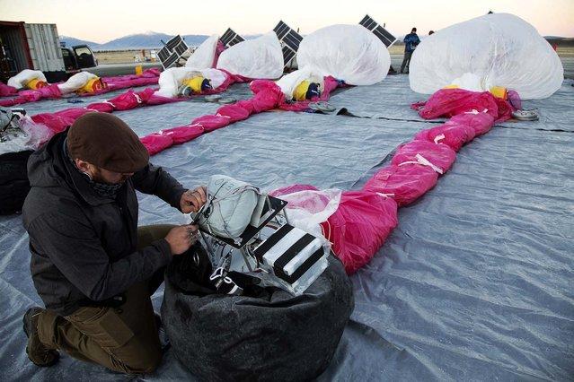 Jordan Miceli prepares electronics to launch balloons in Tekapo, New Zealand. (Photo by Andrea Dunlap/Google)