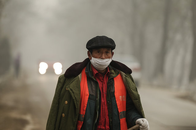 A Chinese worker wearing a mask on a day of heavy pollution on December 1, 2015 in Beijing, China. China's capital and many cities in the northern part of the country recorded the worst smog of the year with air quality devices in some areas unable to read such high levels of pollutants. Levels of PM 2.5, considered the most hazardous, crossed 600 units in Beijing, nearly 25 times the acceptable standard set by the World Health Organization. (Photo by Lintao Zhang/Getty Images)