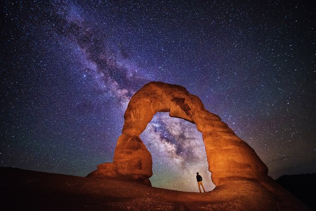 """""""Night at the Arch"""". This is a self portrait I made while photographing the night sky at Delicate Arch in Utah.  (Photo and caption by Max Seigal/National Geographic Traveler Photo Contest)"""