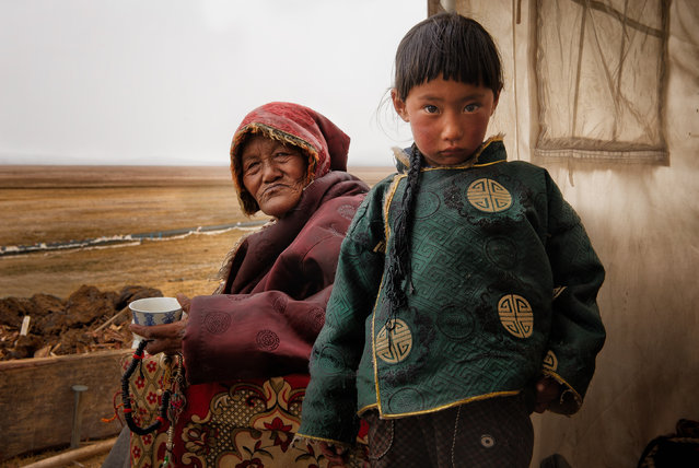 """Granny and me"". A Tibetan grandmother and her granddaughter at the door of their tent in remote Amdo province of historical Tibet at 4400mts high. Nicolas Marino(Photo and caption by /National Geographic Traveler Photo Contest)"
