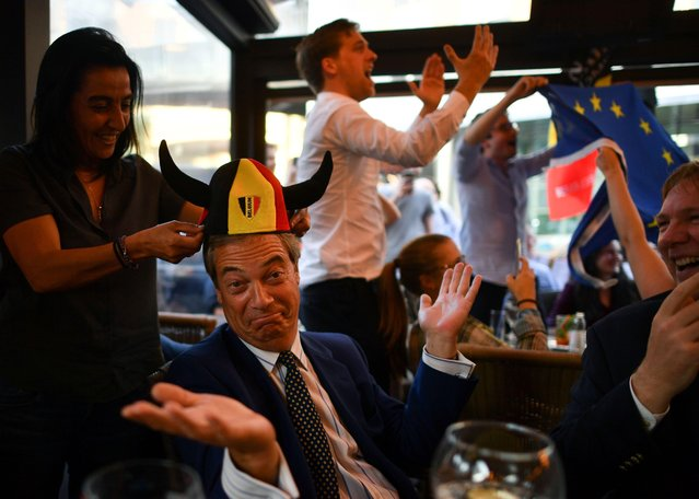 British politician Nigel Farage (C), reacts after a goal for Belgium, at The Beer Factory Bar in Brussels on June 28, 2018, as he watches the Russia 2018 World Cup Group G football match between England and Belgium at the Kaliningrad Stadium in Kaliningrad. (Photo by Ben Stansall/AFP Photo)
