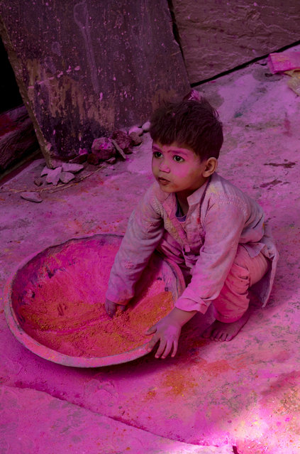 """Child playing with color"". This child was playing Holi festival of color. Location: Vrindavan, India. (Photo and caption by Anirudha Robi Chakraborty/National Geographic Traveler Photo Contest)"