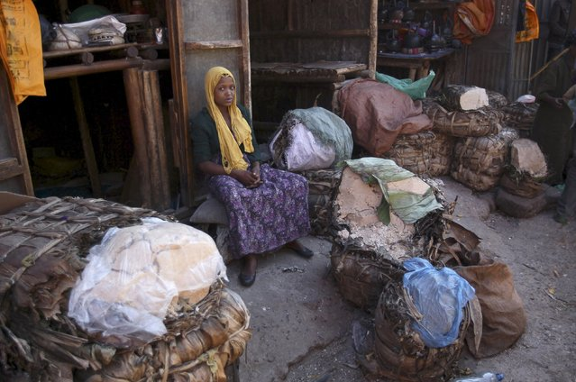 A woman waits for customers next to her belongings at the Mercato market in Addis Ababa October 9, 2015. (Photo by Tiksa Negeri/Reuters)