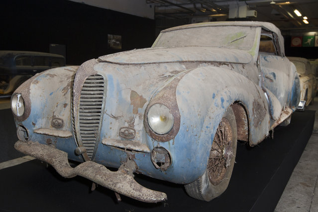 A Delahaye 135-M cabriolet Faget-Varnet is displayed during a preview for an auction of vintage cars Retromobile show in Paris, Tuesday, February 3, 2015, after a treasure trove of classic cars was discovered after spending 50-years languishing in storage on a farm. (Photo by Jacques Brinon/AP Photo)