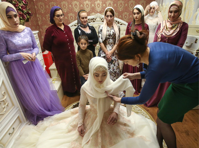 The bride in her room, prepared for a traditional Chechen wedding ceremony in Grozny, Chechnya, Russia on November 24, 2016. (Photo by Valery Sharifulin/TASS)