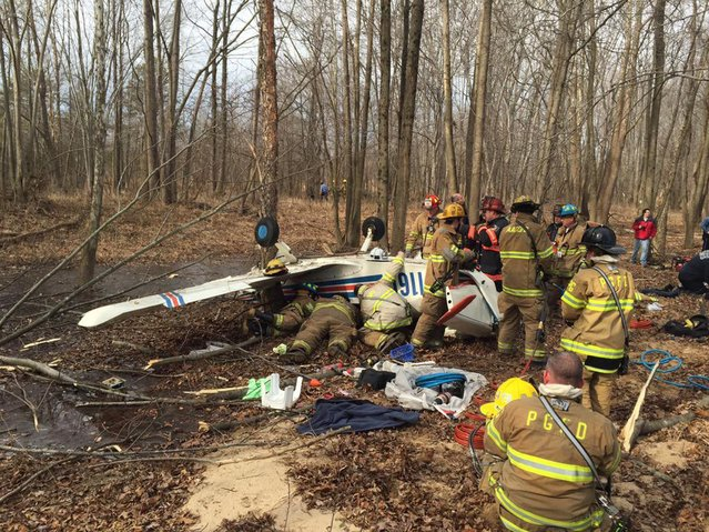Firemen from the Anne Arundel County Fire Department search the wreckage of a Grumman AA-1 aircraft which officials said crashed shortly after take off from Tipton Airport in Odenton, Maryland, in this picture from Anne Arundel County Fire Department Deputy Chief Hoglander taken February 8, 2015. Two people were aboard the plane and were injured in the crash, county officials said. (Photo by Reuters//Anne Arundel County Fire Department Deputy Chief Hoglander)