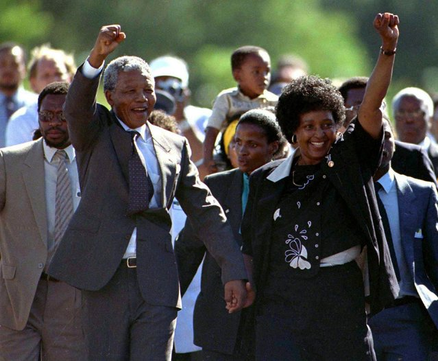Nelson Mandela, accompanied by his wife Winnie, walks out of the Victor Verster prison near Cape Town after spending 27 years in apartheid jails in this February 11, 1990 file photo. (Photo by Ulli Michel/Reuters)