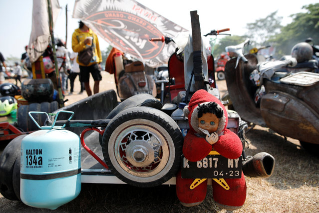 A stuffed toy mascot is tied to the back of an extreme Vespa at a weekend festival for extreme Vespas in Semarang, Central Java, Indonesia, July 22, 2018. (Photo by Darren Whiteside/Reuters)